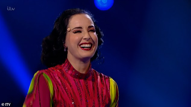 Funny:After her big reveal, Dita - real name Heather Sweet - joked: 'I'd rather be up here taking my clothes off, I'd feel more comfortable!'