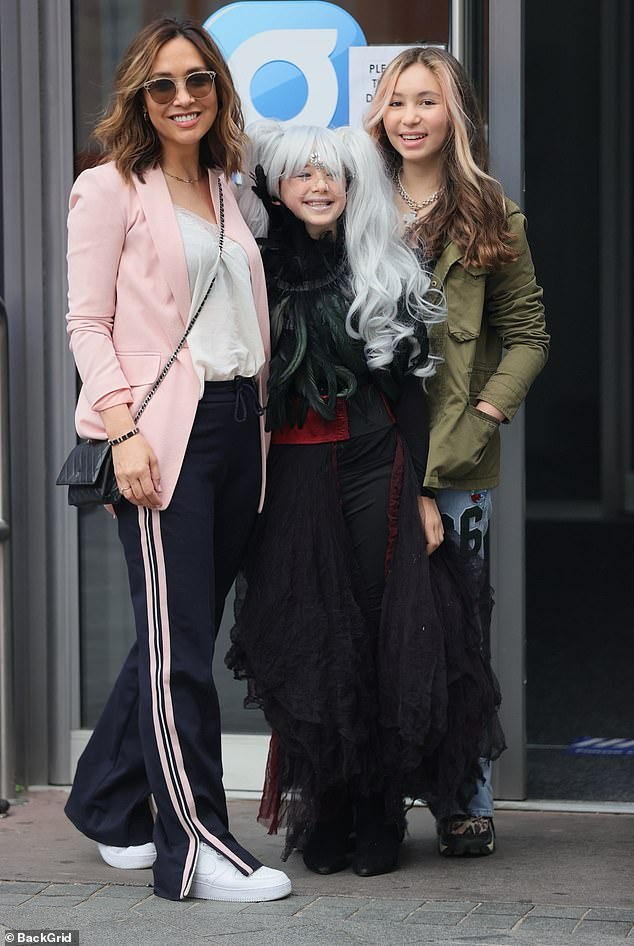 Family outing: Myleene Klass looked effortlessly chic in a pink blazer and white blouse as she and daughters Ava, 13, and Hero, 10, arrived in style at Global Radio studios on Friday