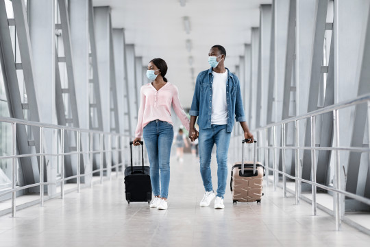couple wearing masks at the airport