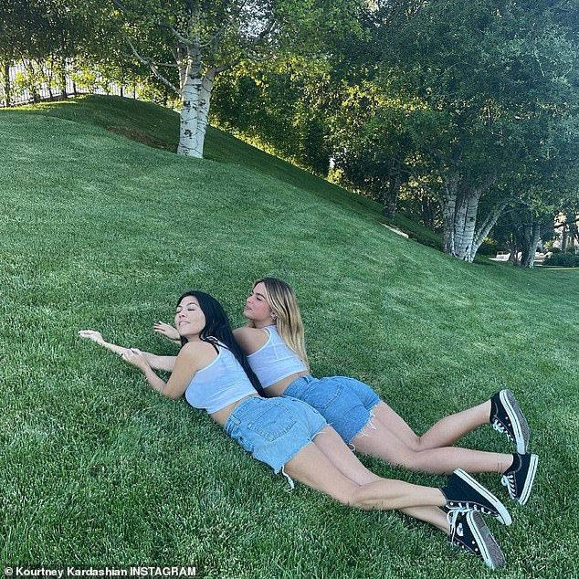 Having a ball:The dynamic duo were lounging on a perfectly manicured grassy slope where they could be seen playfully popping their feet up