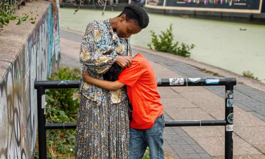 Single parent Barbeline with her son Elijah