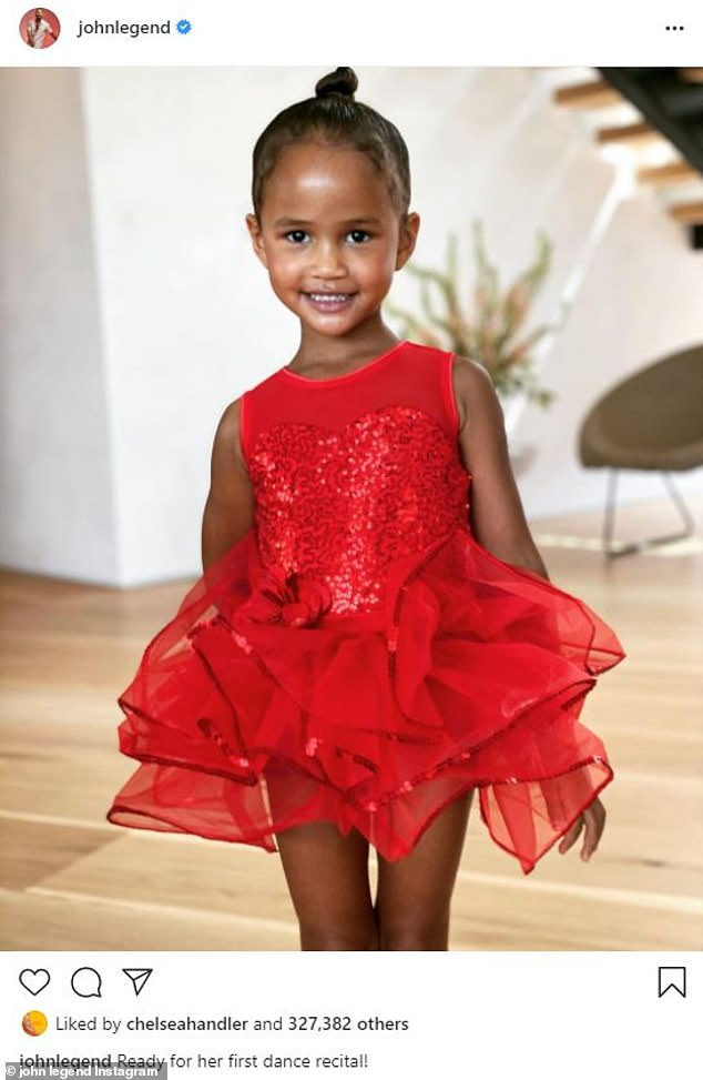 Proud papa: John gushed about Luna's 'first dance recital' in a cute photo showing off her red sequined dress for the performance