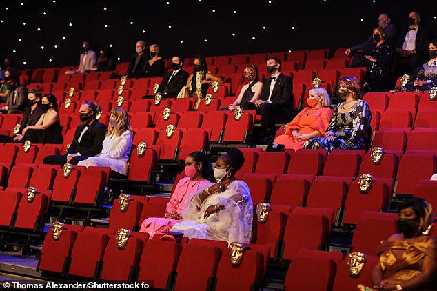 Spread out: The guests and nominees all sat spaced out in the venue to abide by Covid safety rules, and all attendees wore masks unless they took to the stage to present an award