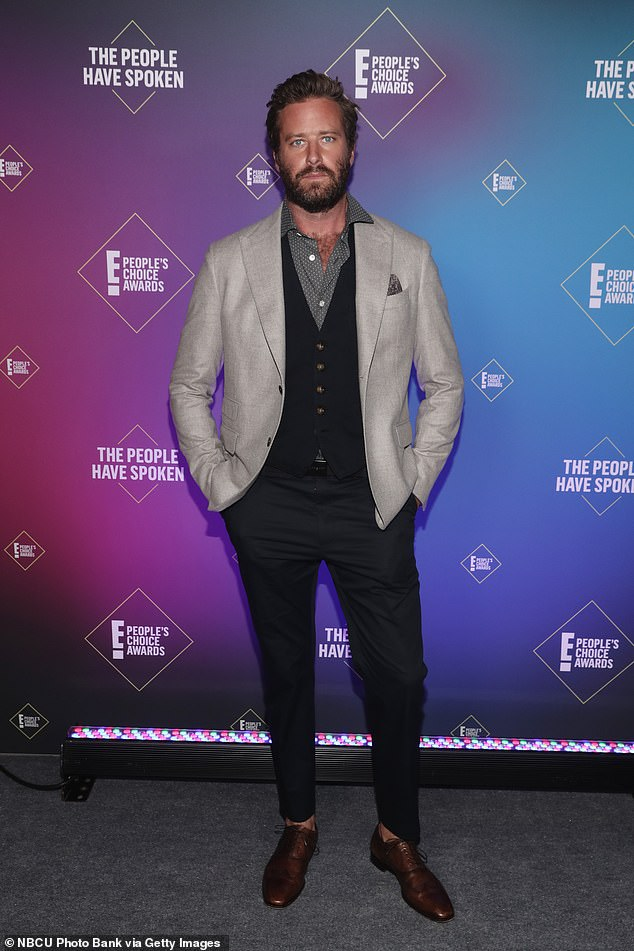 Fall from grace:Armie's woes began in January 2021 when he was rocked by accusations of abuse by several ex-girlfriends along with a series of leaked messages online, purported to be from the star, discussing cannibalism fetishes and rape fantasies; Armie pictured in 2020