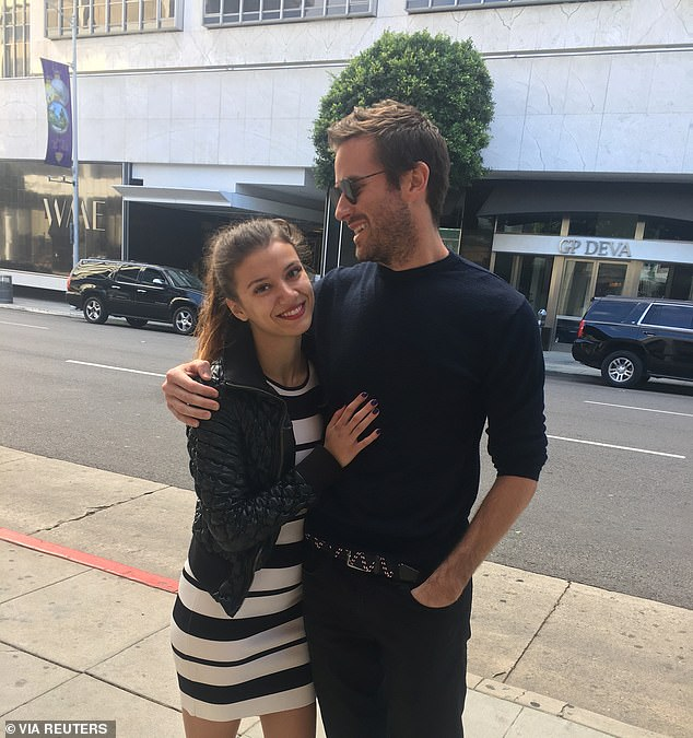 Dark turn:Things took an even darker turn in March when a woman named Effie came forward to accuse the Call Me By Your Name star of violently raping her in hotel room during their four-year relationship; Effie and Armie pictured