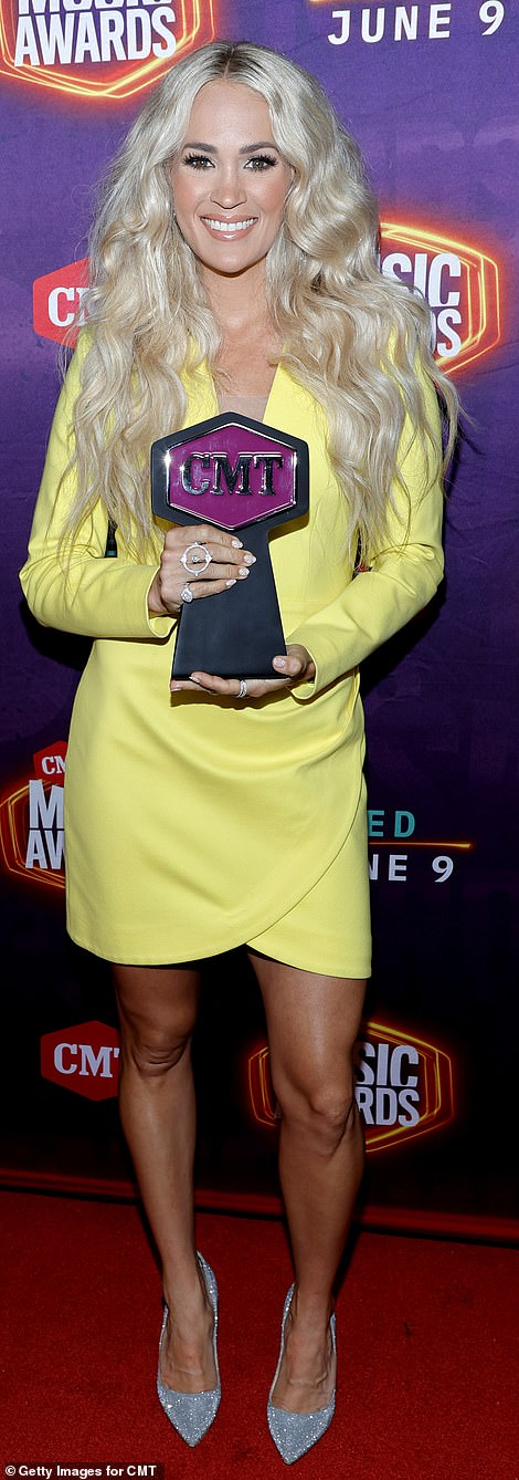 Hello sunshine: The 38-year-old songstress proudly showed off her shiny new trophy backstage after the event