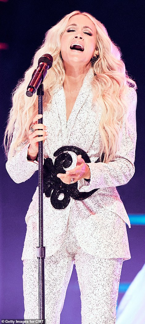 Wonder in white: Though she did not walk the red carpet, earlier in the night the star delivered a powerful performance