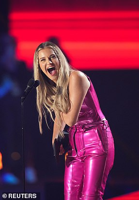 Pleased in pink: Host Kelsea Ballerini won her first CMT Award in the Performance of the Year category with Halsey