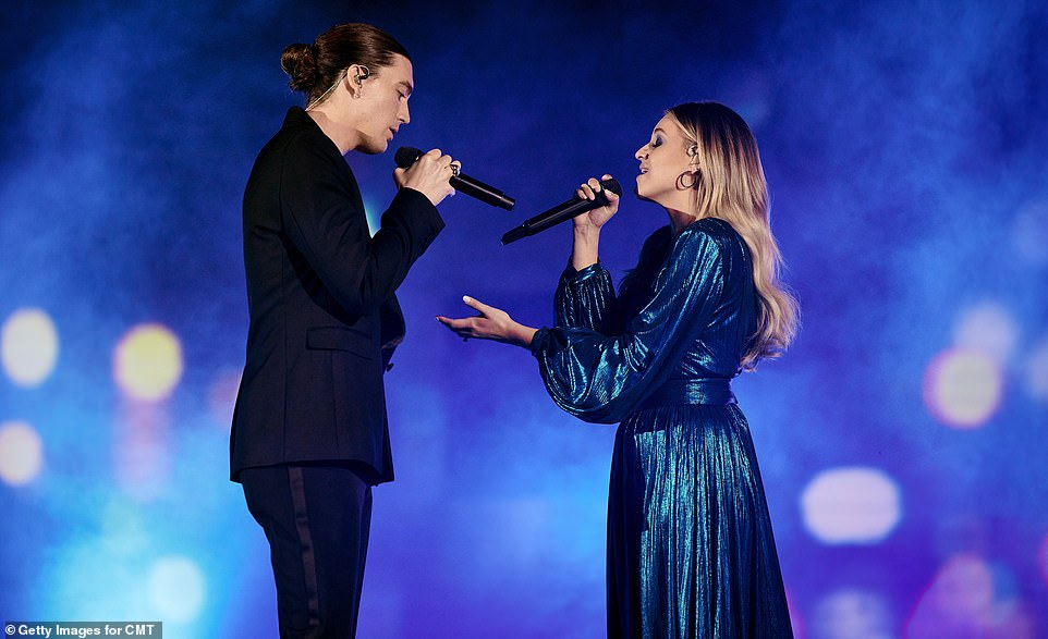 Drying out:Afterward, Brown introduced his cohost Ballerini as she made her first performance of the evening from a Nashville rooftop with Paul Klein. The two made the world television performance premiere of I Quit Drinking