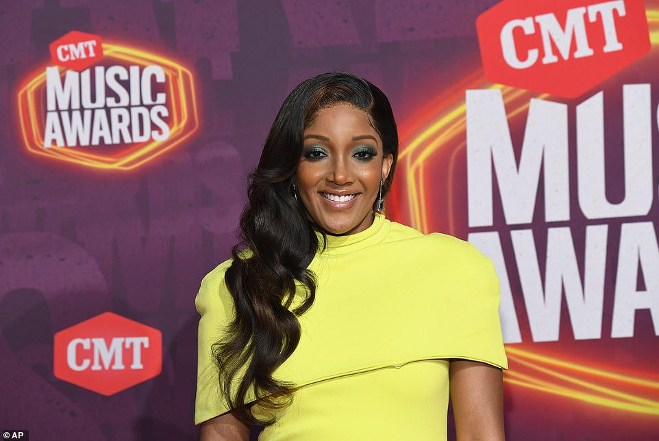 Bringing the drama:Mickey Guyton, who is slated to perform with Gladys Knight, made jaws drop in a pale yellow gown with a dramatic side slit that exposed her shapely legs