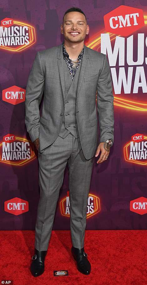 Suave: Kane Brown, who is hosting the ceremony alongside Kelsea Ballerini, looked suave in a grey three-piece suit with a patterned silk shirt layered beneath it