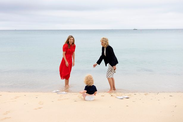 Carrie Johnson and US First Lady Jill Biden paddled on the beach with the PM's son Wilfred