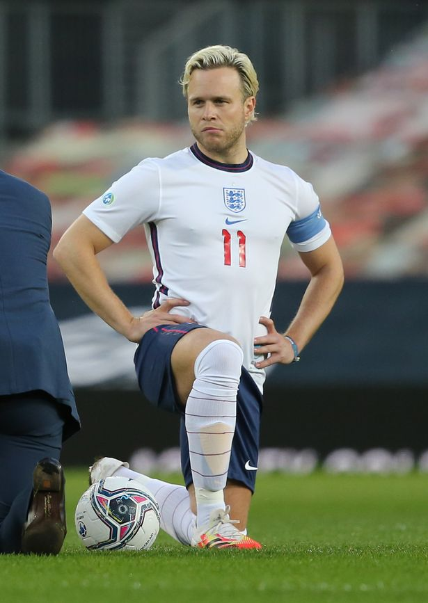Olly Murs of England takes a knee ahead of the Soccer Aid for Unicef match between England and Rest of the World at Old Trafford in September last year