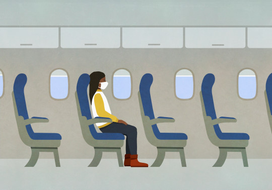 Woman in face mask riding airplane alone