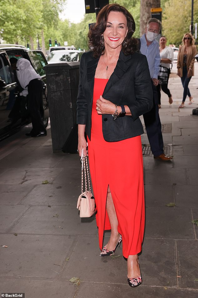 Standing tall: Shirley added height to her frame in a pair of chic floral heels when she stepped out in the capital