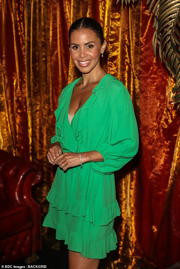 Glam: She made a bold statement in the colourful dress with frilled layers as she headed into Denise's show
