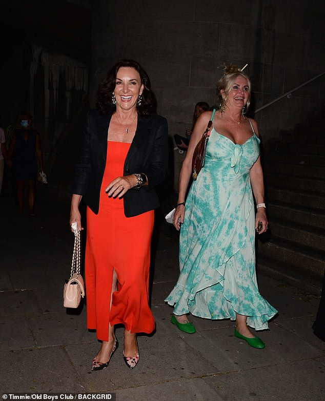 Radiant: Shirley's friend looked equally radiant in a patterned blue dress and the pair could barely stop smiling
