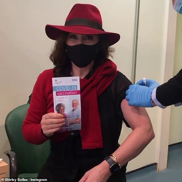 Ill:The Strictly judge contracted the virus in March this year, shortly after having her first vaccination, and was left bedbound for two weeks as a result (pictured getting her vaccine)