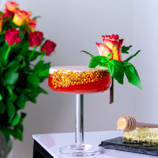 the Great British Summer Unlocktail, with is bright orange and served in a glass coated with bee pollen on the rim