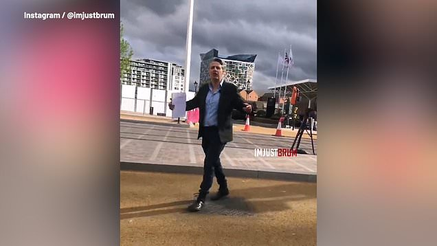 ITV reporter yells at bystander for being in background of broadcast