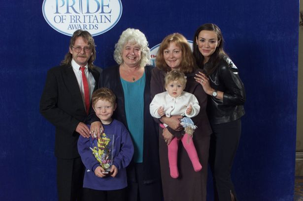 Martine McCutcheon presents Jean Forrest with the Careworker of the Year Award in April 2000