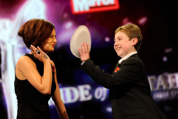 Cheryl Cole gets a pie in the face from Cameron Small winner of the Young Fundraiser of the Year in 2010