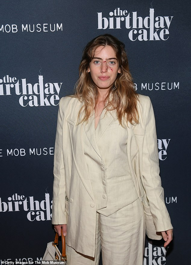 Stylish: The second-generation star wore a khaki three piece suit by Fendi to the Sin City screening