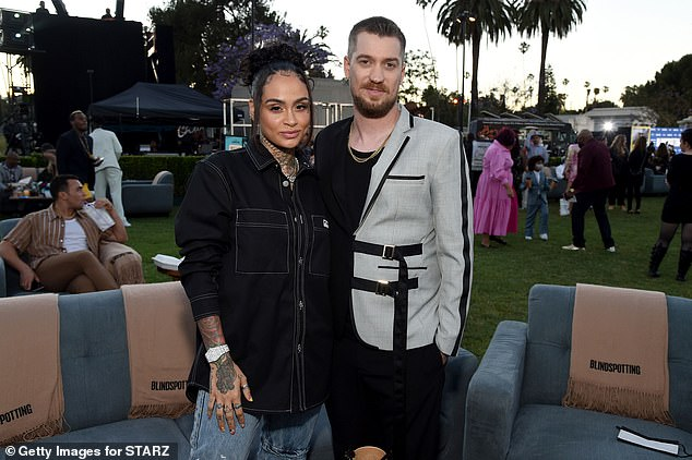 No fuss: The singer Kehlani looked ultra casual in crisp black denim shirt with the sleeves pulled up to show off her luxury wristwatch and abundant tattoos