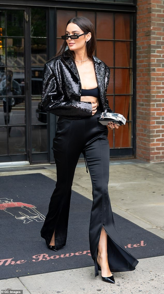 Razzle dazzle!Nicole's daytime outfit consisted of a sequin-covered cropped blazer, satin split-hem trousers and a tiny crop top - all in black