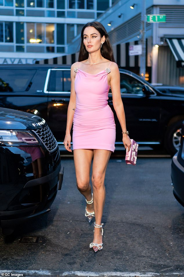 Outfit change:As the sun began to set, Nicole was spotted leaving her hotel in yet another chic look.This time, the glamazon slipped her lithe figure into a light pink mini-dress featuring bejewelled shoulder straps and a cowl neckline