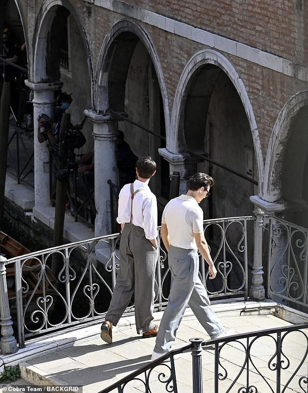 Walk this way: The duo were seen walking across a bridge in a scene