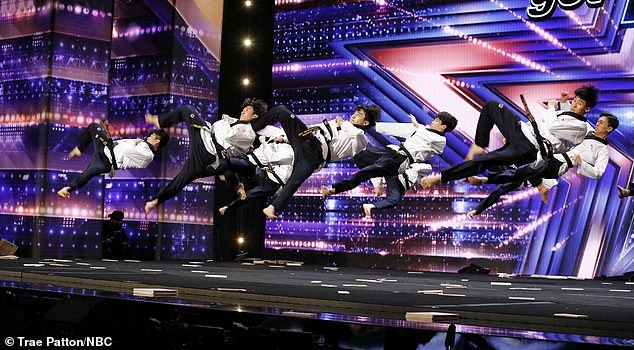 High flying: The team's routine featured high-flying synchronized kicks