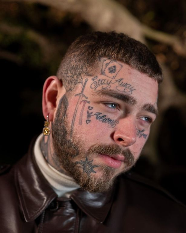 Post Malone with face tattoos