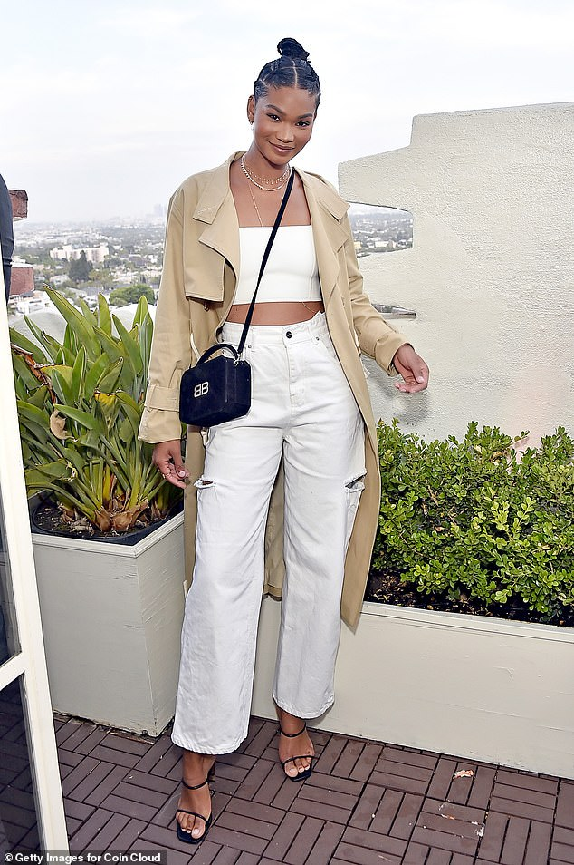 Top of the crops! Chanel Iman flashed her toned abs in a white crop top with matching jeans