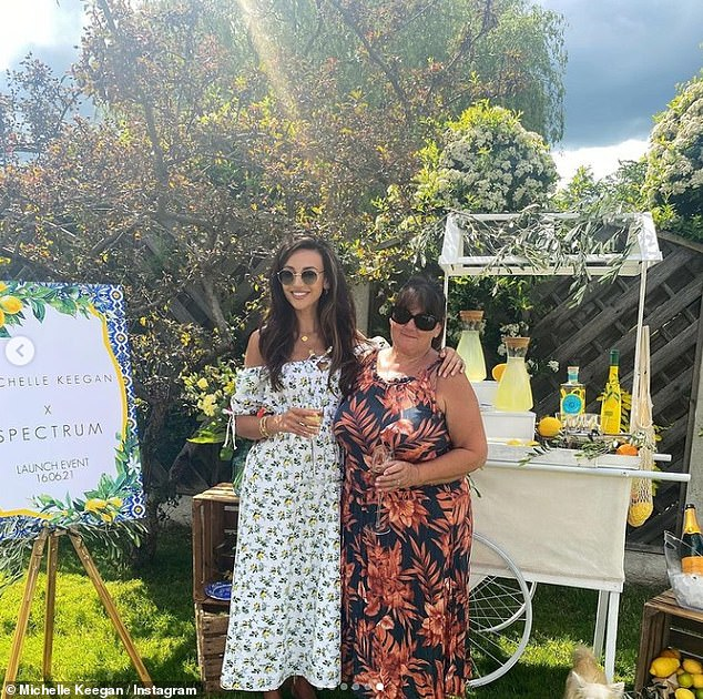 Like mother like daughter:The soap star, 34, looked radiant in a white floral dress, complete with an off-the-shoulder neckline, to promote her new line with Spectrum Collections