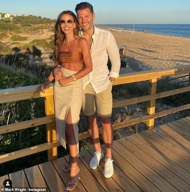 Heading home:Michelle and her husband Mark Wright recently returned to the UK from Portugal before the country joined the 'amber' travel list at 4am last Tuesday