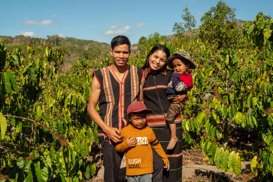 Brothers Khun, 6, and A Khin, 3, with their father, Trun, and mother, Nu, in the family's coffee field.