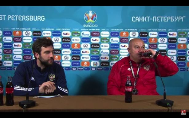 Russia boss Stanislav Cherchesov (right) toasted the win over Finland with a bottle of Coke