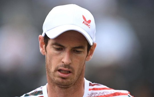 Andy Murray of Great Britain reacts during his Round of 16 match against Matteo Berrettini of Italy during Day 4 of The cinch Championships at The Queen's Club on June 17, 2021 in London, England.
