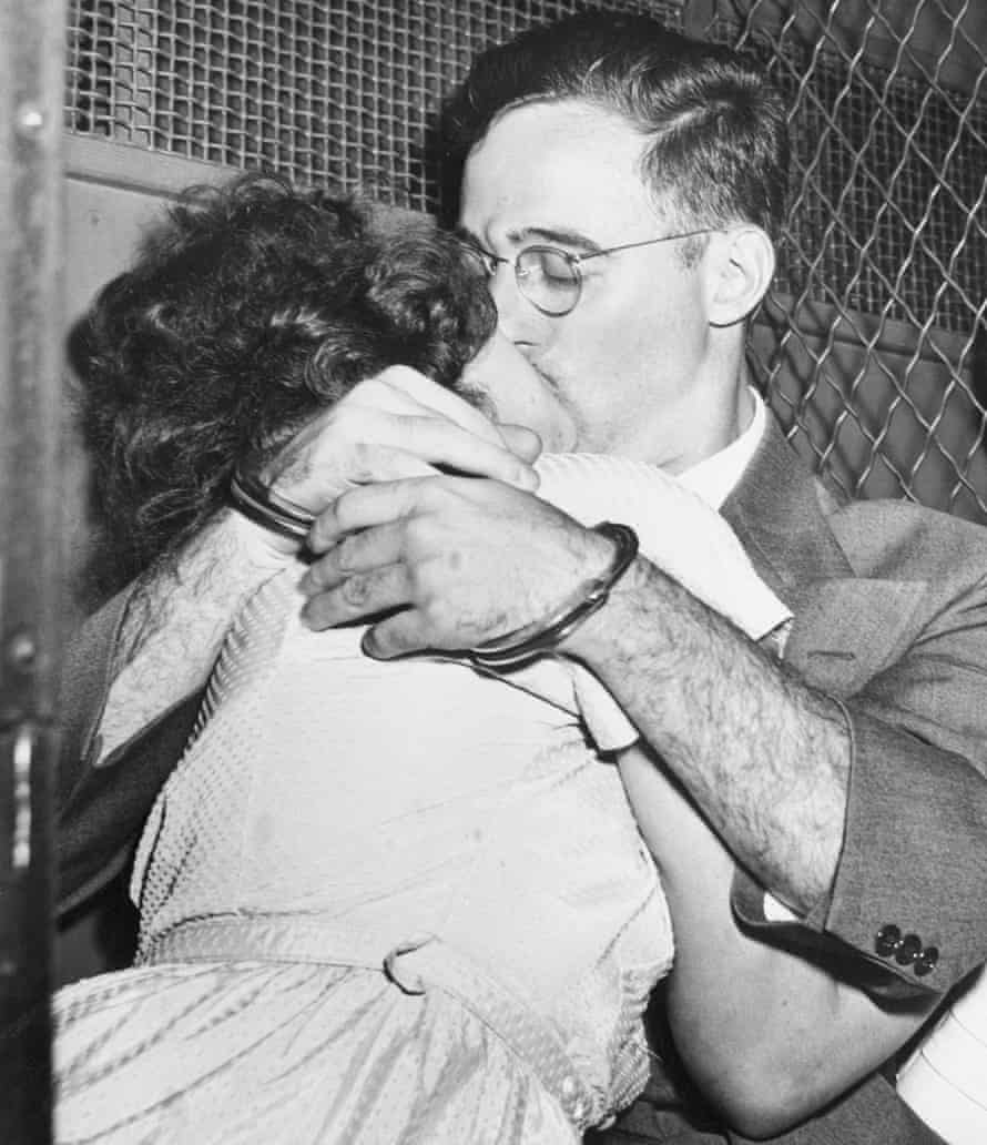 In handcuffs and bound for separate cells, Ethel and Julius Rosenberg share a final kiss in a prison van outside court after their arrest in New York in 1950.