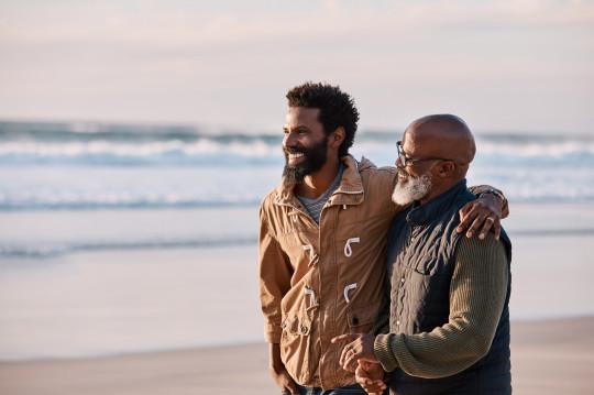 man hugs his elderly father
