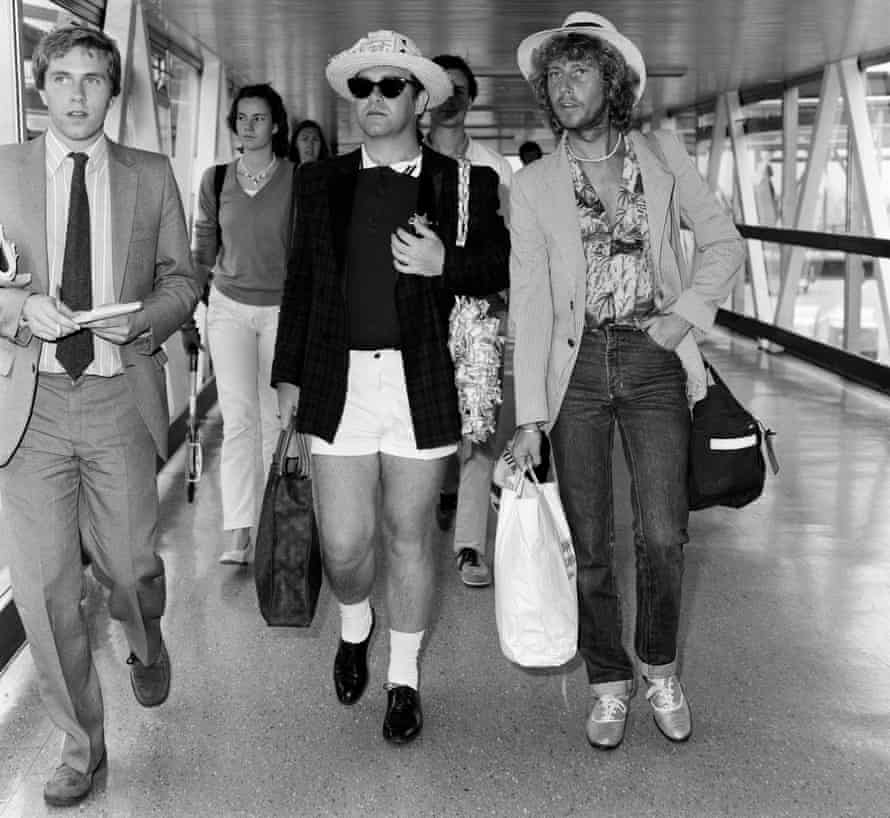Happy landings: Elton John arrives home from his holidays in 1981.