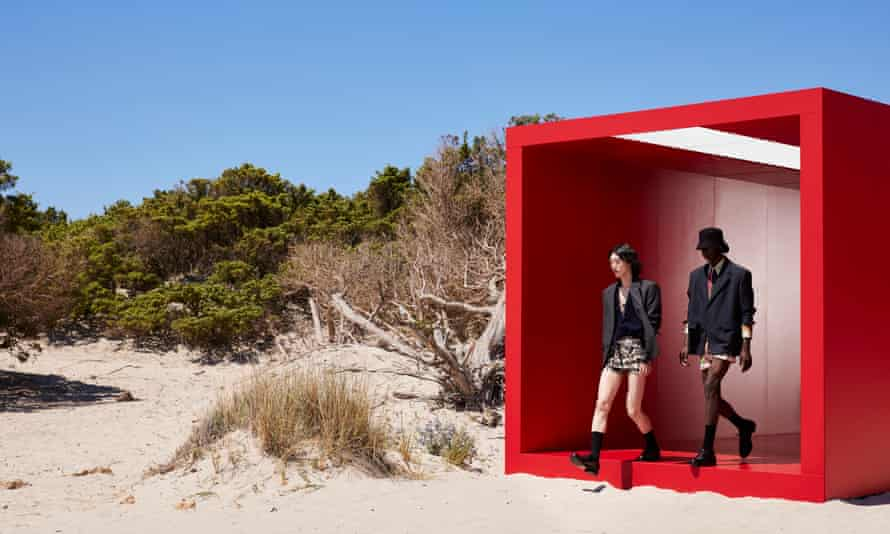 Models emerge on to the sunkissed Sardinian beach.