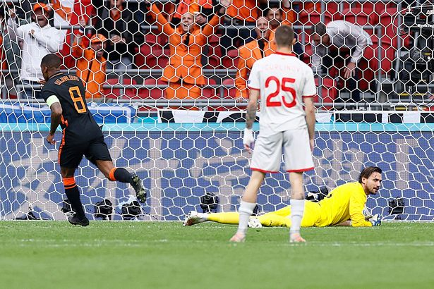 Georginio Wijnaldum doubles the Netherlands' lead after being set up by Depay