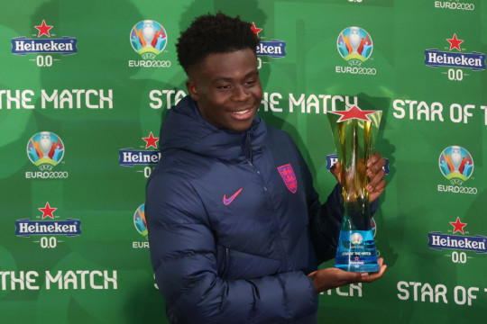 Bukayo Saka of England poses with his man of the match award during the UEFA Euro 2020 Championship Group D match between Czech Republic and England at Wembley Stadium on June 22, 2021 in London, United Kingdom.