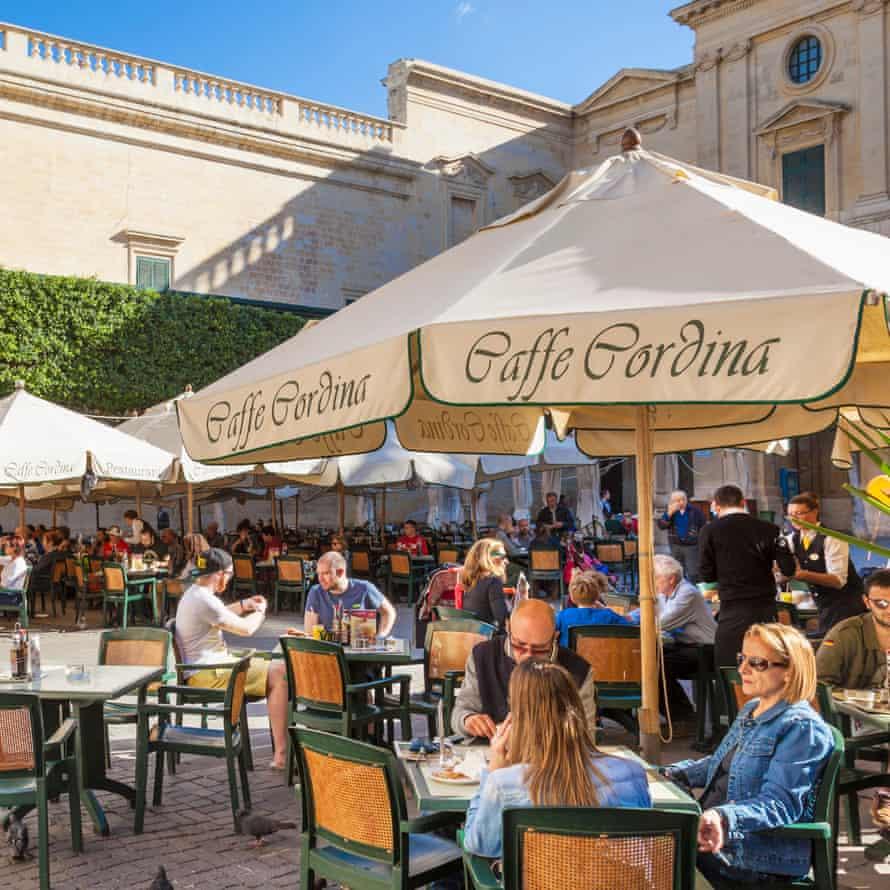 Tourists at the Cafe Cordina, Valletta, Malta.