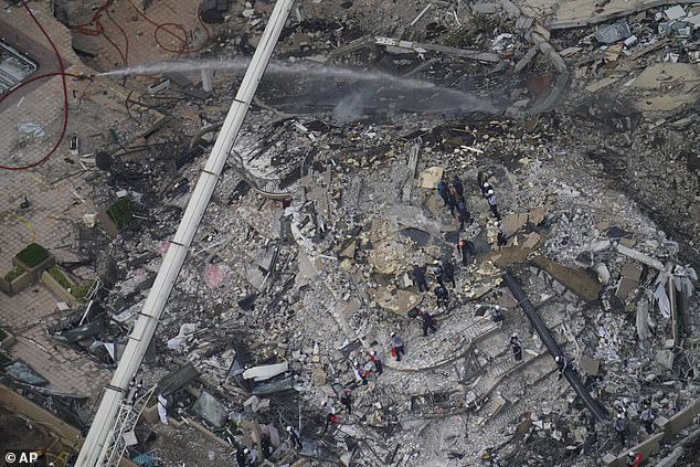 Tense times: 130 people have now been accounted for and 156 others are listed as still missing following the collapse of the 12-story residential building, Champlain Towers, early Thursday