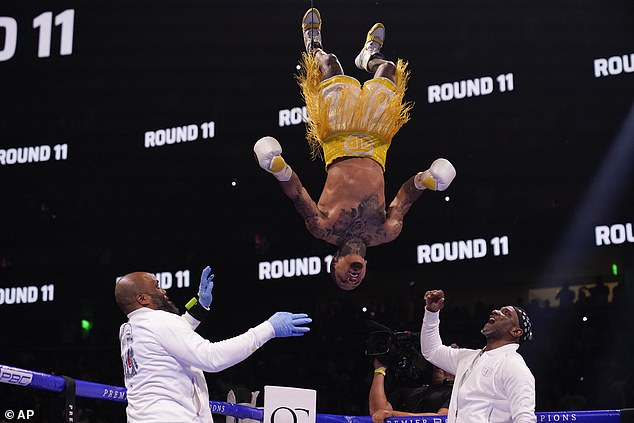 Mayweather's victorious Davis reportedly raked in $26million for the night. Davis is seen celebrating with a backflip after winning the match