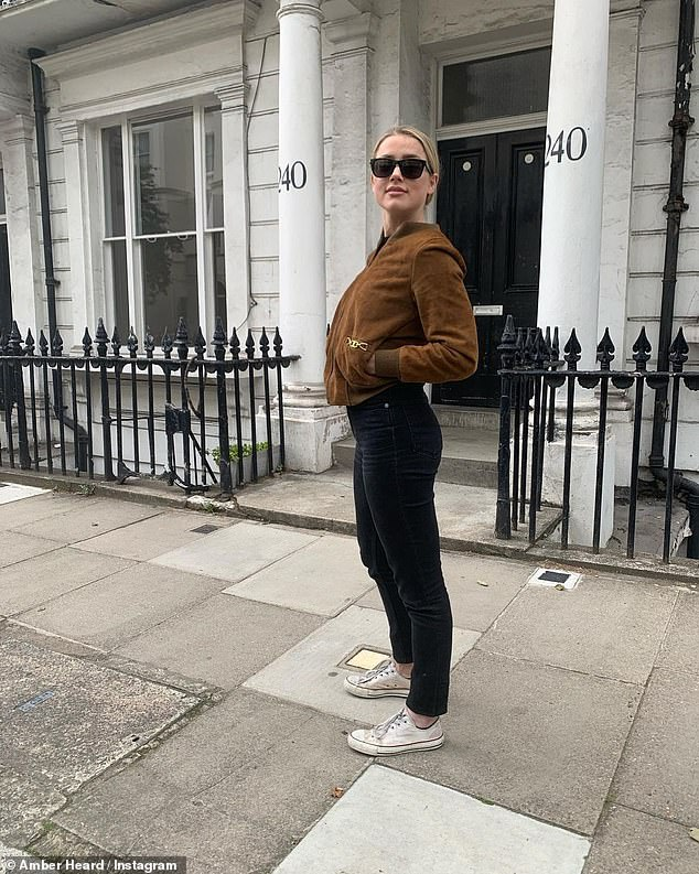 Casual: The Hollywood star cut a casual figure in a black top, skinny-leg jeans, a brown bomber jacket and well-worn sneakers. She accessorised further with stylish dark sunglasses, and tied her blonde locks into a sleek style at the nape of the neck