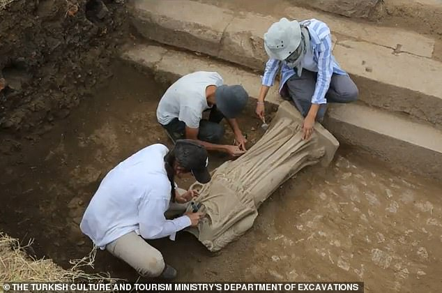Though the figure's head and arms are missing archaeologists say she is otherwise quite well-preserved